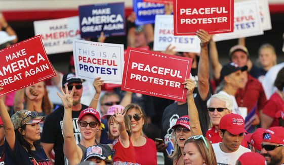 President Donald Trump supporters rally prior to the start of a political rally at the Minden-Tahoe Airport in Minden, Nev., Saturday, Sept. 12, 2020. (AP Photo/Lance Iversen)