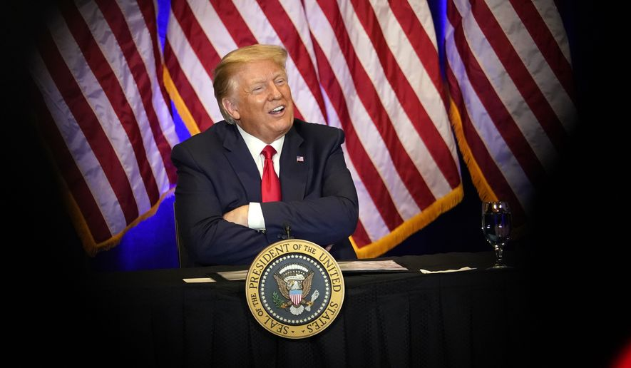 President Donald Trump smiles during a Latinos for Trump Coalition roundtable at Treasure Island Hotel & Casino, Sunday, Sept. 13, 2020, in Las Vegas. (AP Photo/Andrew Harnik)