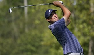 Scottie Scheffler hits from the 12th tee during the first round of the BMW Championship golf tournament, Thursday, Aug. 27, 2020, at Olympia Fields Country Club in Olympia Fields, Ill. (AP Photo/Charles Rex Arbogast)