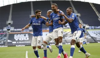 Everton's Dominic Calvert-Lewin, second right, celebrates with teammates after scoring his side's opening goal during the English Premier League soccer match between Tottenham Hotspur and Everton at the Tottenham Hotspur Stadium in London, Sunday, Sept. 13, 2020. (Cath Ivill/Pool via AP)