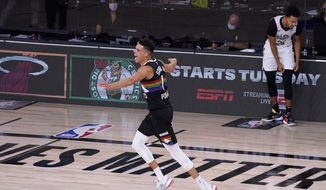 Denver Nuggets' Michael Porter Jr. (1) celebrates after making a 3-pointer against the Los Angeles Clippers during the second half of an NBA conference semifinal playoff basketball game Sunday, Sept. 13, 2020, in Lake Buena Vista, Fla. (AP Photo/Mark J. Terrill)
