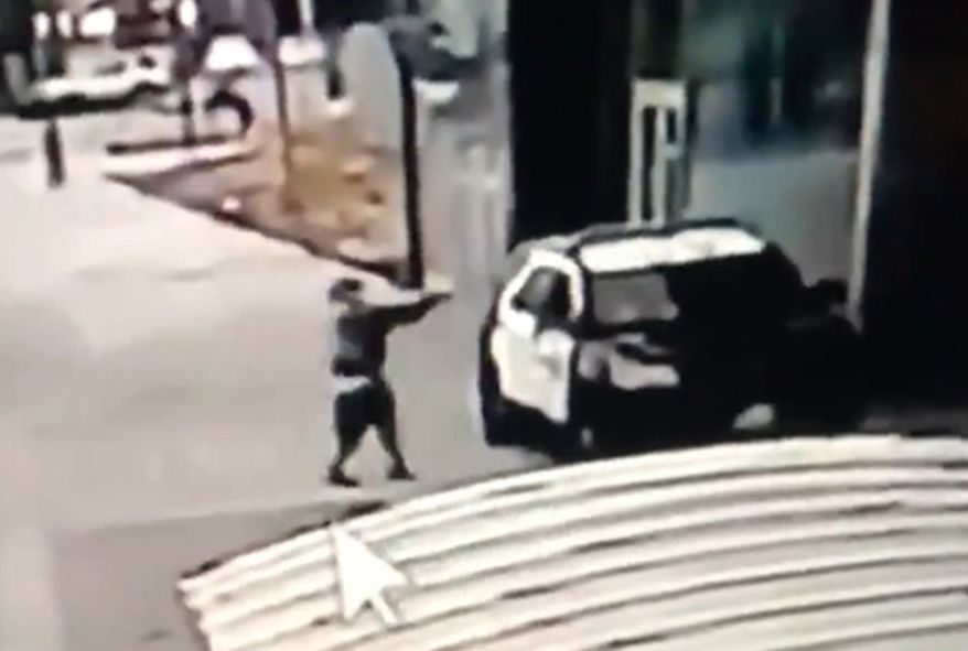 A screen grab from a security camera video released the Los Angeles County Sheriff's Department shows a gunman walking up to sheriff's deputies and opening fire without warning or provocation in Compton, Calif., on Saturday, Sept. 12, 2020. Officials say two Los Angeles County sheriff's deputies were shot in their patrol car at a Metro rail station in what appeared to be an ambush. The sheriff's department said the male and female deputies were shot in the head and had multiple gunshot wounds and were undergoing surgery. Deputies were searching for a suspect. (Los Angeles County Sheriff's Department via AP)