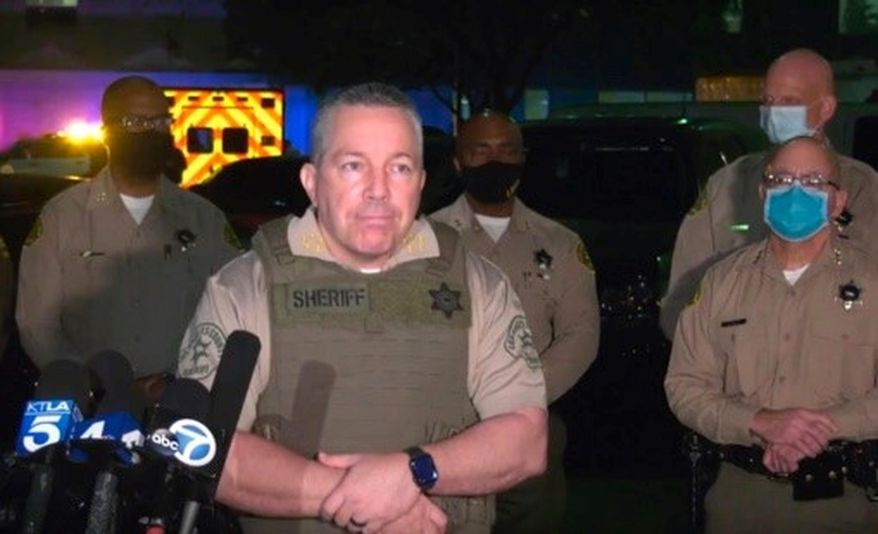 This Saturday, Sept. 12, 2020, still image taken from video released by the Los Angeles County Sheriff's Department, shows Los Angeles Sheriff Alex Villanueva taking questions at a late-night news conference about the condition of two Sheriff's deputies in Compton, Calif. Authorities searched Sunday for a gunman who shot and wounded two Los Angeles County sheriff's deputies who were sitting in their squad car, an apparent ambush that drew an angry response from the president and sparked an anti-police protest outside the hospital where the deputies were being treated. (Los Angeles County Sheriff's Department via AP)