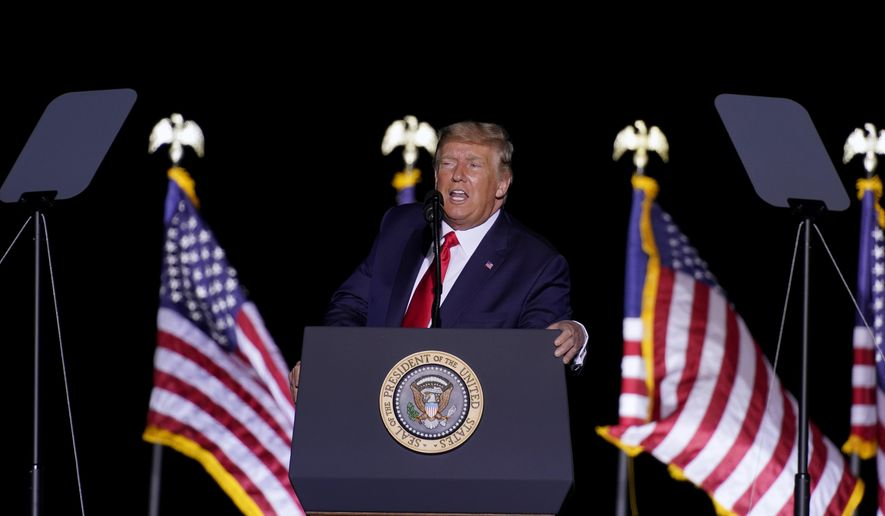 President Donald Trump speaks at a rally at Minden-Tahoe Airport in Minden, Nev., Saturday, Sept. 12, 2020. (AP Photo/Andrew Harnik)