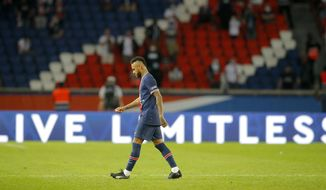 PSG's Neymar leaves the pitch after getting a red card during the French League One soccer match between Paris Saint-Germain and Marseille at the Parc des Princes in Paris, France, Sunday, Sept.13, 2020. (AP Photo/Michel Euler)