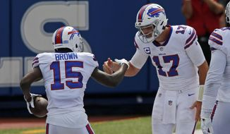 Buffalo Bills wide receiver John Brown (15) celebrates with quarterback Josh Allen after they connected on a pass play for a touchdown during the first half of an NFL football game against the New York Jets in Orchard Park, N.Y., Sunday, Sept. 13, 2020. (AP Photo/Jeffrey T. Barnes)