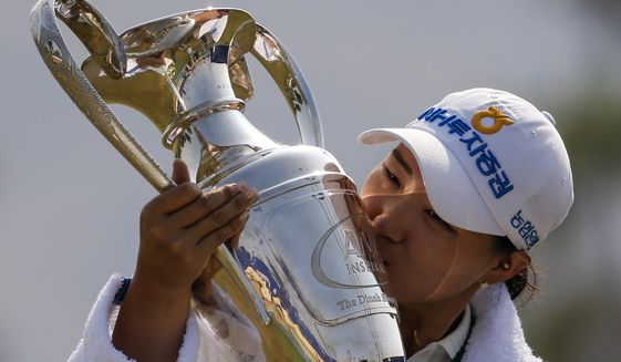 Mirim Lee, of South Korea, kisses the championship trophy after winning the LPGA's ANA Inspiration golf tournament at Mission Hills Country Club in Rancho Mirage, Calif., Sunday Sept. 13, 2020. (AP Photo/Ringo H.W. Chiu)
