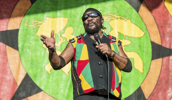 FILE - In this May 3, 2018 file photo, Toots Hibbert of Toots and the Maytals performs at the New Orleans Jazz and Heritage Festival in New Orleans. In a statement from a family member, Hibbert died on Friday, Sept. 11, 2020. (Photo by Amy Harris/Invision/AP, File)