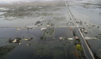 State Highway 27 leading to Cameron, La. is seen in Creole, La., Friday, Aug. 28 2020, as the storm surge recedes in the aftermath of Hurricane Laura. (AP Photo/Gerald Herbert)