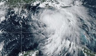 This satellite photo provided by the National Oceanic and Atmospheric Administration shows Tropical Storm Sally, Sunday, Sept. 13, 2020, at 2050 GMT. Sally churned northward on Sunday, poised to turn into a hurricane and send a life-threatening storm surge along the northern Gulf of Mexico. (NOAA via AP)