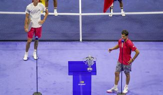 Dominic Thiem, of Austria, right, speaks after defeating Alexander Zverev, of Germany, in the men's singles final of the US Open tennis championships, Sunday, Sept. 13, 2020, in New York. (AP Photo/Seth Wenig)