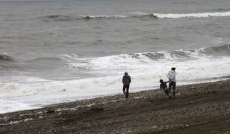 Alaskans comb the beach along the Bering Sea to clean up debris. The exact origin of the garbage that washed up this summer is unclear, but local leaders said it was unlike anything they had seen before. (Associated Press)
