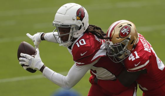 Arizona Cardinals wide receiver DeAndre Hopkins (10) catches a pass against San Francisco 49ers cornerback Emmanuel Moseley (41) during the first half of an NFL football game in Santa Clara, Calif., Sunday, Sept. 13, 2020. (AP Photo/Josie Lepe)