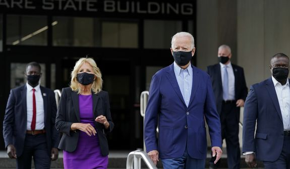 Democratic presidential candidate and former Vice President Joe Biden and his wife Jill Biden depart after voting early in Delaware's state primary election at the New Castle County Board of Elections office in Wilmington, Del., Monday, Sept. 14, 2020. (AP Photo/Patrick Semansky)