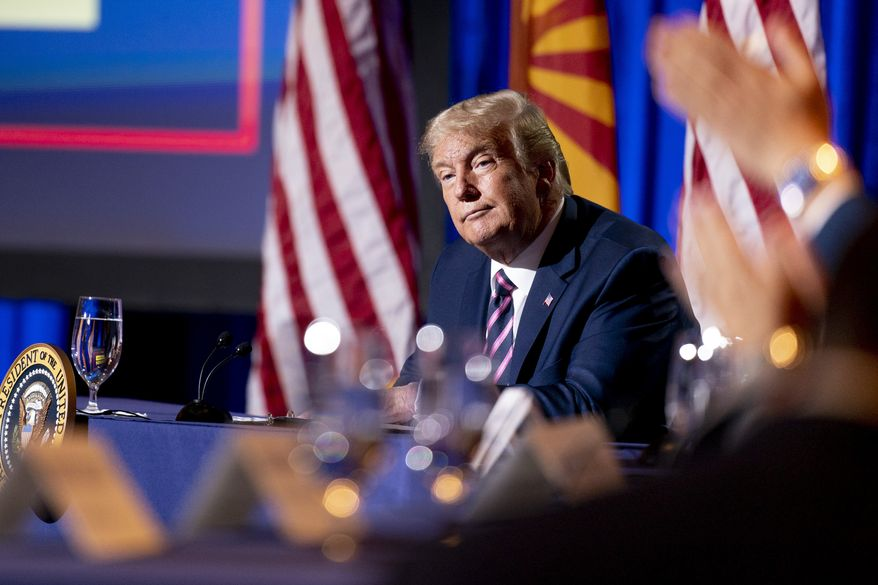President Donald Trump listens during a Latinos for Trump Coalition roundtable campaign event at Arizona Grand Resort & Spa, Monday, Sept. 14, 2020, in Phoenix. (AP Photo/Andrew Harnik)
