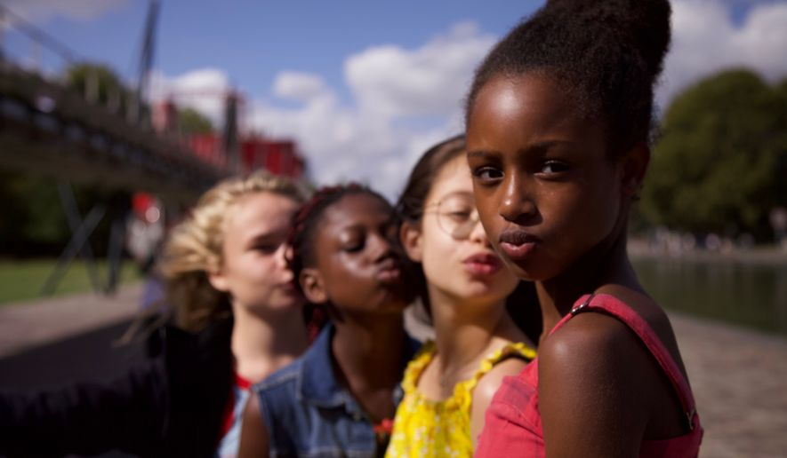 "This image released by Netflix shows the cast of the coming-of-age film ""Cuties."" The backlash to the French independent film Mignonnes, or Cuties, started before it had even been released because of a poster that went viral for its provocative depiction of its young female actors. (Netflix via AP, File)"