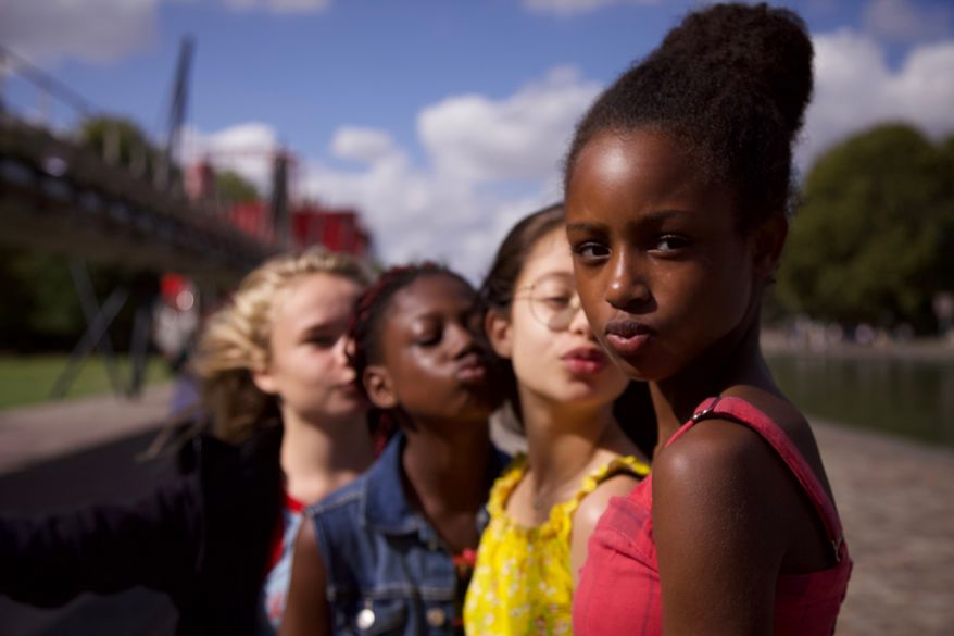 """This image released by Netflix shows the cast of the coming-of-age film """"Cuties."""" The backlash to the French independent film Mignonnes, or Cuties, started before it had even been released because of a poster that went viral for its provocative depiction of its young female actors. (Netflix via AP, File)"""