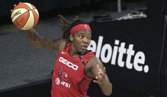 Washington Mystics forward Myisha Hines-Allen, left, grabs a rebound during the second half of a WNBA basketball game against the Los Angeles Sparks, Thursday, Sept. 10, 2020, in Bradenton, Fla. (AP Photo/Phelan M. Ebenhack) **FILE**