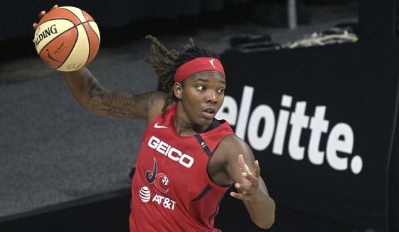 Washington Mystics forward Myisha Hines-Allen, left, grabs a rebound during the second half of a WNBA basketball game against the Los Angeles Sparks, Thursday, Sept. 10, 2020, in Bradenton, Fla. (AP Photo/Phelan M. Ebenhack)