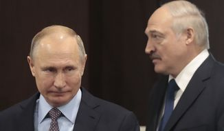In this file photo taken on Friday, Feb. 15, 2019, Russian President Vladimir Putin, left, and Belarusian President Alexander Lukashenko meet in the Black sea resort of Sochi, Russia. Alexander Lukashenko's talks with Russian President Vladimir Putin on Monday, Sept. 14, 2020, in the Black Sea resort of Sochi come a day after an estimated 150,000 people flooded the streets of the Belarusian capital, demanding Lukashenko's resignation. (Sergei Chirikov/Pool Photo via AP, File)