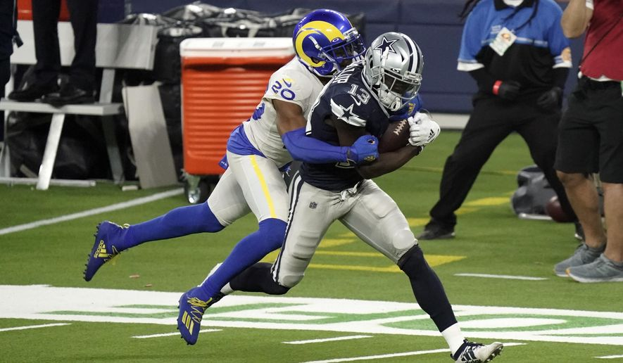 Dallas Cowboys wide receiver Michael Gallup (13) makes a catch but is called for offensive pass interference on Los Angeles Rams cornerback Jalen Ramsey, left, during the second half of an NFL football game Sunday, Sept. 13, 2020, in Inglewood, Calif. (AP Photo/Jae C. Hong)