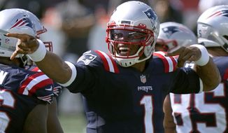 New England Patriots quarterback Cam Newton signals a first down in the second half of an NFL football game against the Miami Dolphins, Sunday, Sept. 13, 2020, in Foxborough, Mass. (AP Photo/Steven Senne)