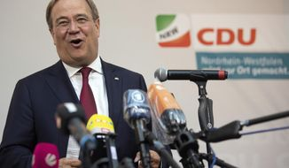 In this Sept. 13, 2020 taken photo Armin Laschet, Prime Minister of North Rhine-Westphalia, makes a statement after the polling stations are closed in Duesseldorf, Germany. Chancellor Angela Merkel's center-right party easily defended its position as the strongest force in Germany's most populous region in municipal elections, a result that may boost the state governor's position as he vies to succeed the country's longtime leader. (Federico Gambarini/dpa via AP)