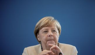 Chancellor Angela Merkel takes part in the meeting of the CDU Federal Executive Committee in Berlin, Germany, Monday, Sept. 14, 2020. The meeting was held in hybrid presence and virtually. (Michael Kappeler/Pool via AP)