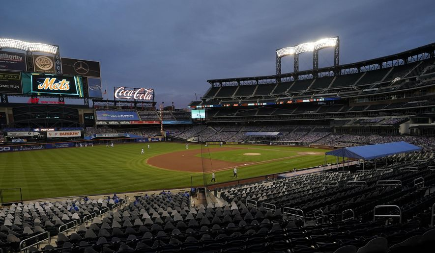 In this Sept. 9, 2020, file photo, Citi Field is viewed at dusk before a baseball game between the New York Mets and the Baltimore Orioles in New York. Billionaire hedge fund manager Steve Cohen has agreed to purchase the Mets from the Wilpon family. The team announced the agreement on Monday, Sept. 14, 2020. The deal is subject to the approval of Major League Baseball owners. (AP Photo/Kathy Willens, File)  **FILE**
