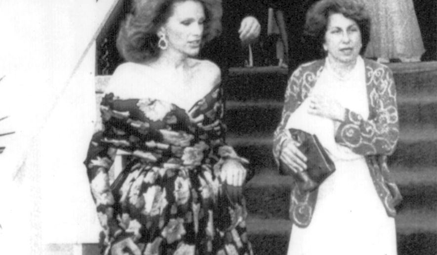 FILE - In this September 1983, file photo, Ann Getty, left, is followed by her husband, Gordon Getty, into Symphony Hall during opening night in San Francisco. Ann Getty, a longtime benefactor of the arts and culture in San Francisco, died Monday, Sept. 14, 2020. She was 79. She died of a heart attack, her husband Gordon Getty said. A native of Wheatland, California, Ann Getty and her husband Gordon Getty, an oil heir and billionaire philanthropist, were a regular presence of San Francisco's society events. At right are city administrator Roger Boas and his wife Nancy. (AP Photo/Eric Luse, File)