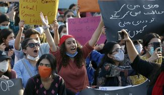 Members of Women Democratic Front chant slogans during a rally to condemn the incident of rape on a deserted highway, in Islamabad, Pakistan, Saturday, Sept. 12, 2020. Pakistani police said they detained 15 people for questioning after two armed men allegedly gang raped a woman in front of her children after her car broke down on a deserted highway near the eastern city of Lahore. (AP Photo/Anjum Naveed)