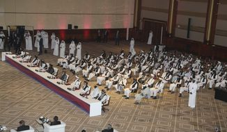 Taliban delegation attend the opening session of the peace talks between the Afghan government and the Taliban in Doha, Qatar, Saturday, Sept. 12, 2020. (AP Photo/Hussein Sayed)