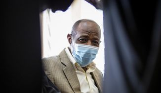 """Paul Rusesabagina, who inspired the film """"Hotel Rwanda"""" for saving people from genocide, appears at the Kicukiro Primary Court in the capital Kigali, Rwanda Monday, Sept. 14, 2020. Rusesabagina became famous for protecting more than 1,000 people as a hotel manager during Rwanda's 1994 genocide and was awarded the U.S. Presidential Medal of Freedom in 2005 but Rwandan authorities accused him of supporting the armed wing of his opposition political platform, which has claimed responsibility for deadly attacks inside Rwanda. (AP Photo)"""