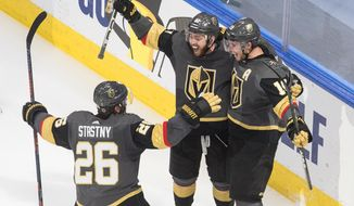 Vegas Golden Knights' Reilly Smith (19) celebrates his goal against the Dallas Stars with Paul Stastny (26) and Jonathan Marchessault (81) during third-period NHL Western Conference final playoff game action in Edmonton, Alberta, Monday, Sept. 14, 2020. (Jason Franson/The Canadian Press via AP)