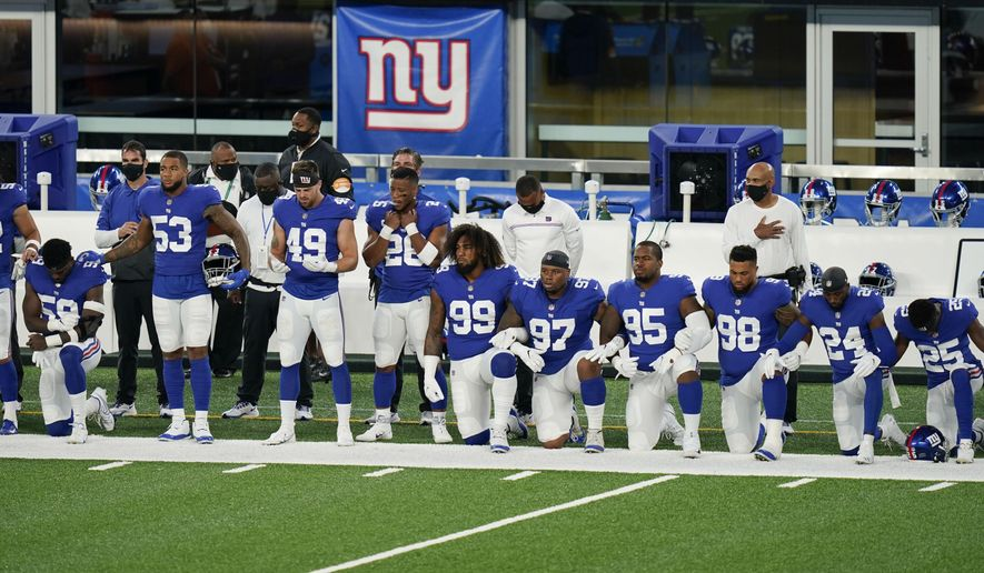 New York Giants players kneel on the field before playing against the Pittsburgh Steelers in an NFL football game Monday, Sept. 14, 2020, in East Rutherford, N.J. (AP Photo/Seth Wenig)