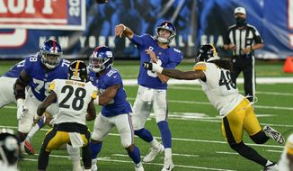 New York Giants quarterback Daniel Jones (8) passes under pressure from Pittsburgh Steelers outside linebacker Bud Dupree (48) during the second quarter of an NFL football game Monday, Sept. 14, 2020, in East Rutherford, N.J. (AP Photo/Seth Wenig)