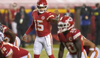 Kansas City Chiefs quarterback Patrick Mahomes (15) directs a teammate in the second half of an NFL football game against the Houston Texans Thursday, Sept. 10, 2020, in Kansas City, Mo. (AP Photo/Jeff Roberson)