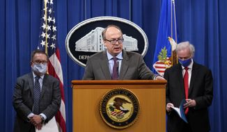 Jeff Clark, assistant attorney general for the Environment and Natural Resources Division, speaks as Deputy Attorney General Jeffrey Rosen, right, and Environmental Protection Agency (EPA) Administrator Andrew Wheeler, left, look on during a news conference at the Justice Department in Washington, Monday, Sept. 14, 2020. (AP Photo/Susan Walsh, Pool) ** FILE **