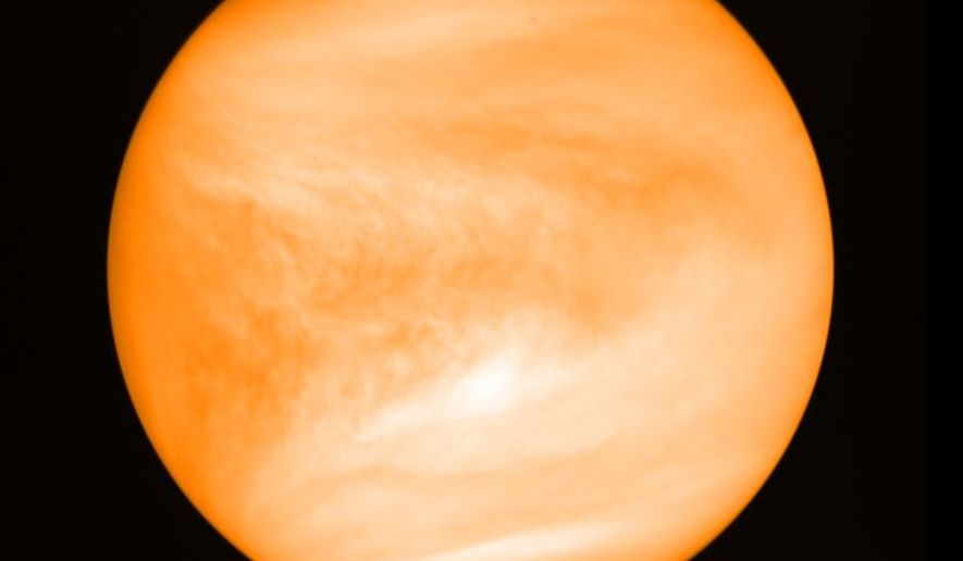 This May 2016 photo provided by researcher Jane Greaves shows the planet Venus, seen from the Japan Aerospace Exploration Agency's Akatsuki probe. A report released on Monday, Sept. 14, 2020, says astronomers have found a potential signal of life high in the atmosphere of our nearest neighboring planet. (J. Greaves/Cardiff University/JAXA via AP)