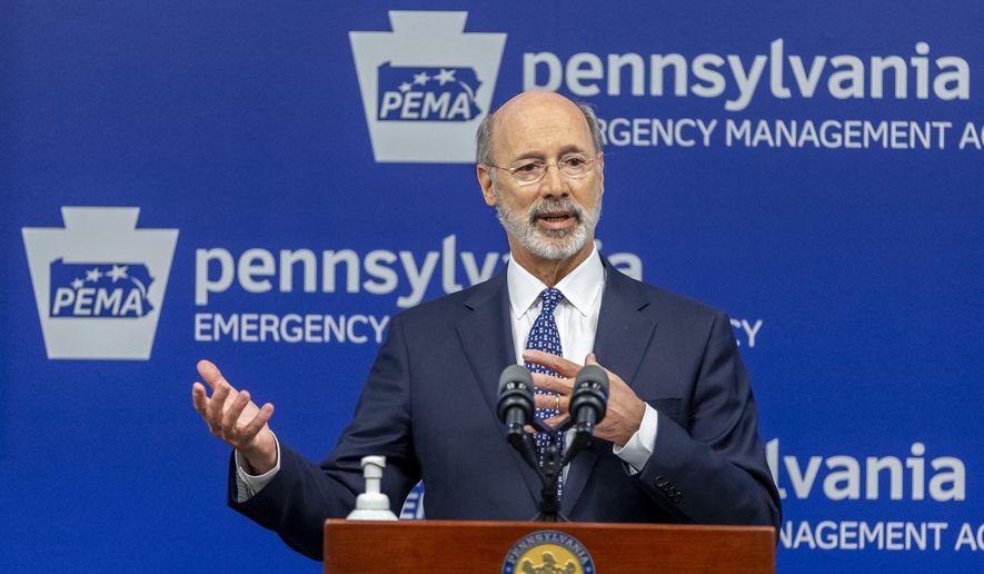 In this May 29, 2020, file photo, Pennsylvania Gov. Tom Wolf meets with the media at The Pennsylvania Emergency Management Agency (PEMA) headquarters in Harrisburg, Pa. (Joe Hermitt/The Patriot-News via AP, File)