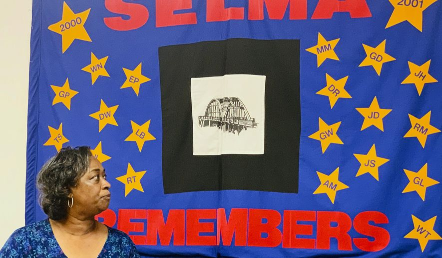Mel Prince, executive director of Selma AIR, looks at a quilt that remembers people who lost their lives to AIDS, at her office in Selma, Ala., on Sept 3, 2020. The coronavirus pandemic has disrupted the delivery of all types of health care services in the U.S., and the fight against HIV has not been spared. Health experts and HIV advocates worry the country is at risk of backsliding, with a spike in new HIV infections. The issue is of particular concern in the South, which has been a focus of the Trump administration's goal of eradicating the disease by 2030. (AP Photo/Kim Chandler)