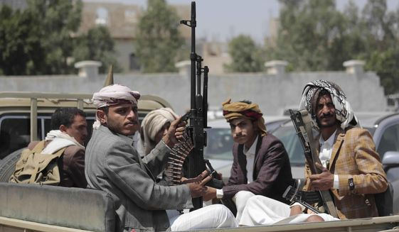 Tribesmen loyal to Houthi rebels hold their weapons as they ride in a vehicle during a gathering against the agreement to establish diplomatic relations between Israel and the United Arab Emirates, in Sanaa, Yemen.  (AP Photo/Hani Mohammed, File)
