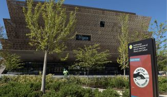 The Smithsonian's National Museum of African American History and Culture is shown in this file photo. Two new Smithsonian history museums, one centered on the American Latino and the other for American women, were authorized in the coronavirus relief bill that recently passed Congress.  (Associated Press)  **FILE**