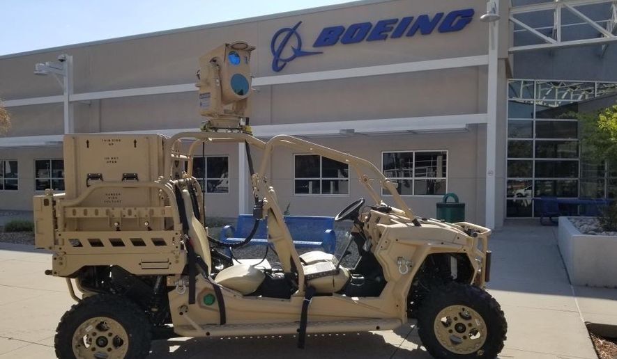 The Air Force successfully tested Boeing's Compact Laser Weapon System (CLWS), which was mounted on top of a small military vehicle and was able to protect a convoy from simulated drone attacks. (Photo used with permission from Boeing)