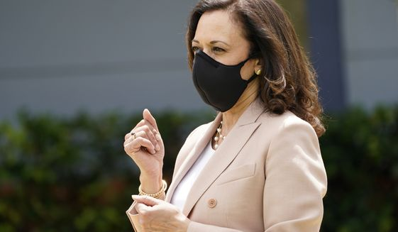 Democratic vice presidential candidate Sen. Kamala Harris, D-Calif., listens to the Florida Memorial University marching band on Sept. 10, 2020, in Miami Gardens, Fla. Harris is drawing on her past as the U.S. faces a reckoning over policing. (AP Photo/Lynne Sladky)