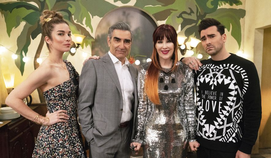 """This image released by Pop TV shows, from left, Annie Murphy, Eugene Levy, Catherine O'Hara and Dan Levy from the series """"Schitt's Creek."""" The program is nominated for an Emmy Award for outstanding comedy series. (Pop TV via AP)"""