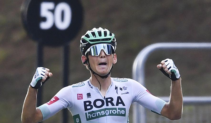 German Lennard Kamna crosses the finish line to win stage 16 of the Tour de France cycling race over 164 kilometers (102 miles) from La Tour-du-Pin to Villard-de-Lans, France, Tuesday, Sept. 15, 2020. (Stuart Franklin/Pool via AP)