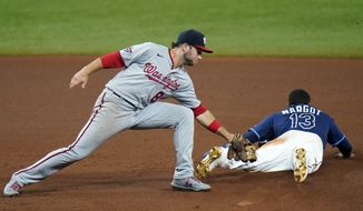 Tampa Bay Rays' Manuel Margot (13) steals second base as Washington Nationals shortstop Carter Kieboom (8) is late with the tag during the seventh inning of a baseball game Tuesday, Sept. 15, 2020, in St. Petersburg, Fla. (AP Photo/Chris O'Meara)