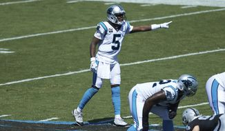 Carolina Panthers quarterback Teddy Bridgewater (5) directs his offense during an NFL football game against the Las Vegas Raiders, Sunday, Sept. 13, 2020, in Charlotte, N.C. (AP Photo/Brian Westerholt)
