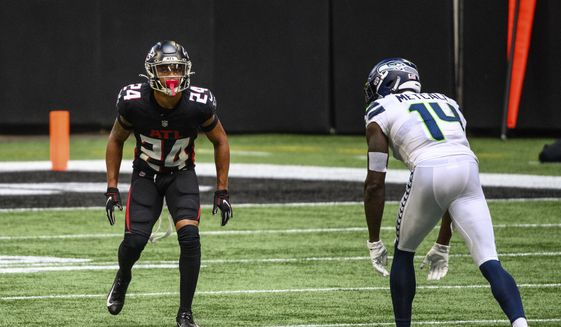Atlanta Falcons cornerback A.J. Terrell (24) lines up across from Seattle Seahawks wide receiver DK Metcalf (14) during the second half of an NFL football game, Sunday, Sept. 13, 2020, in Atlanta. The Seattle Seahawks won 38-25. (AP Photo/Danny Karnik)  **FILE**